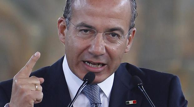 Mexico's president Felipe Calderon delivers his State of the Nation address in Mexico City (AP)