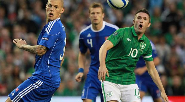 Robbie Keane (right) and Martin Skrtel (left) battle for the ball during the European Championship Qualifying match at the Aviva Stadium, Dublin
