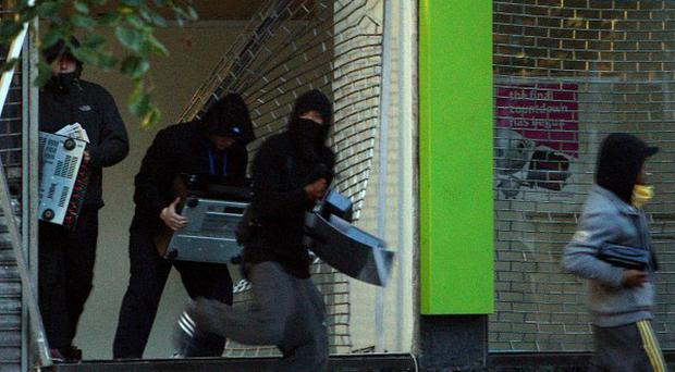 Rioters should be treated by the courts like 'any other case' the head of the Crown Prosecution Service has cautioned