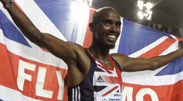 Mo Farah celebrates after winning the gold medal in the men's 5,000 metres final at the World Athletics Championships in Daegu (AP)
