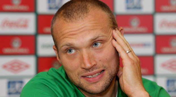 Warren Feeney talks to the media in Tallinn yesterday