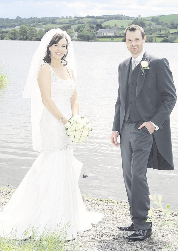 "Leonne and Alan enjoying their wedding day at Macauley's lake, Spa with the church in the background <p><b>To send us your Wedding Pics <a href=""http://www.belfasttelegraph.co.uk/usersubmission/the-belfast-telegraph-wants-to-hear-from-you-13927437.html"" title=""Click here to send your pics to Belfast Telegraph"">Click here</a> </a></p></b>"