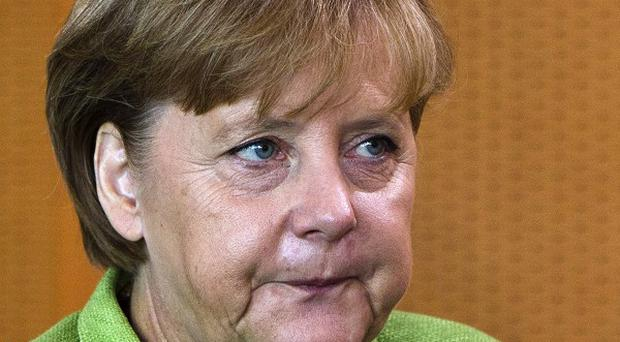 Chancellor Angela Merkel's coalition has suffered a new blow in Germany's state elections (AP)