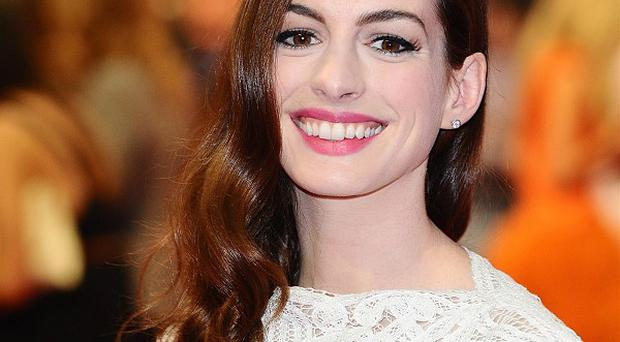 Anne Hathaway says playing Catwoman is a dream come true