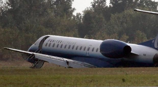 A United Express plane sits in the grass after it slid off the runway at Ottawa Airport, Canada (AP)