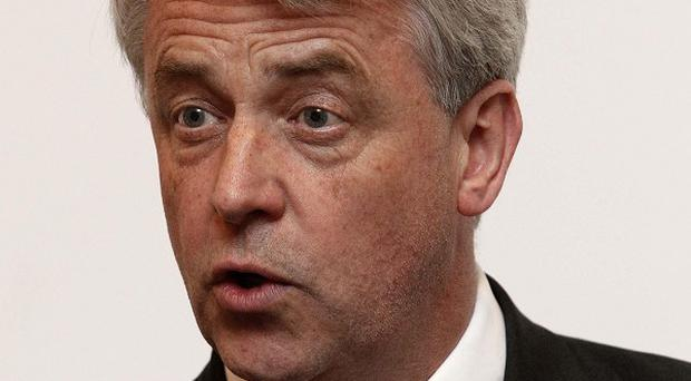 Health Secretary Andrew Lansley has defended the Government's NHS reforms following criticism from businessman Sir Gerry Robinson