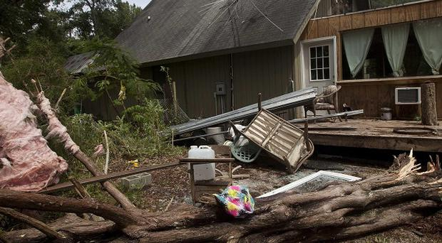 Debris lies around a house in Alabama after Tropical Storm Lee hit the US Gulf Coast (AP)