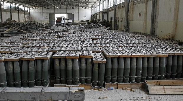 Weapons and tank shells found in a Libyan State industrial complex by rebels, China has admitted that some of its arms companies held talks with Gaddafi aides(AP)