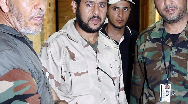 Libyan rebel commander Abdel Hakim Belhaj, centre, claims UK intelligence agents knew he was being tortured but did nothing to help him (AP)