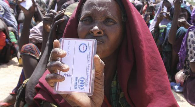 One of the more fortunate refugees in Mogadishu. Somalia, who has found food and shelter in a UN camp (AP)