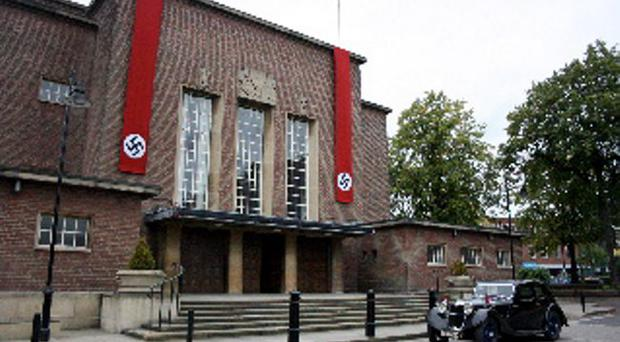 Germany calling: Nazi flags hang from Queen's University's Whitla Hall during filming of a documentary on the life of Frank Ryan