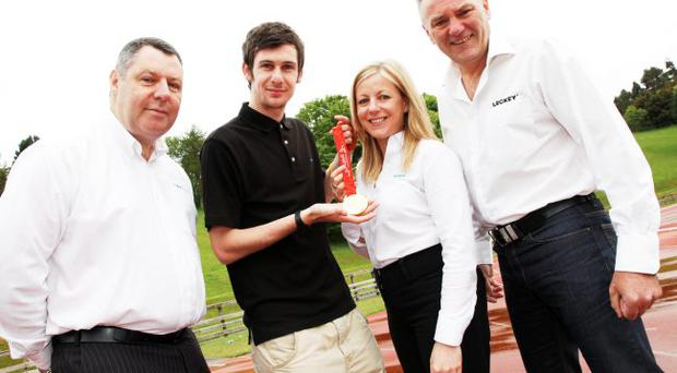 Michael McKillop shows off his Beijing gold medal with Leckey's Gary O'Hagan (left), Gilian Parker and James Leckey
