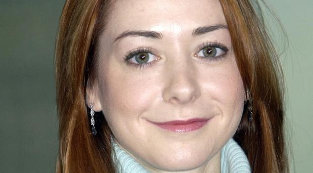 Alyson Hannigan says she is definitely not pregnant