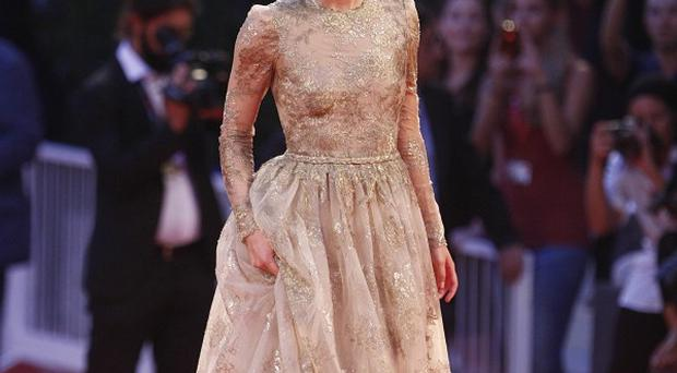 Keira Knightley may wear glamorous frocks on the red carpet, but she insists she's a tomboy at heart