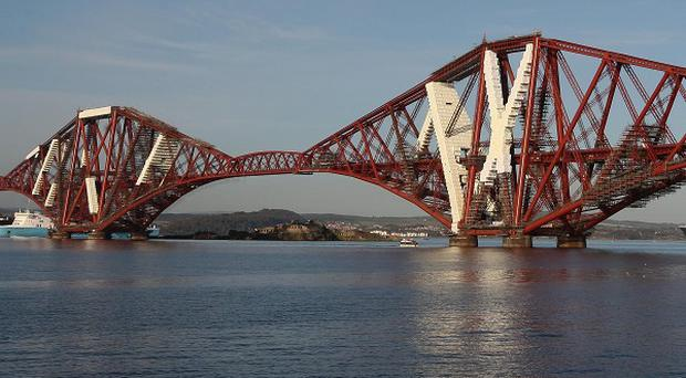 The Forth Bridge will not need repainting for another 25 years after a new long-lasting paint is applied