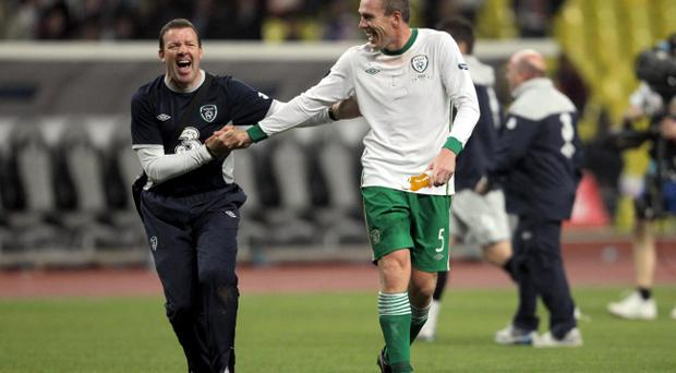 A jubilant Richard Dunne with goalkeeping coach Alan Kelly at the end of the game