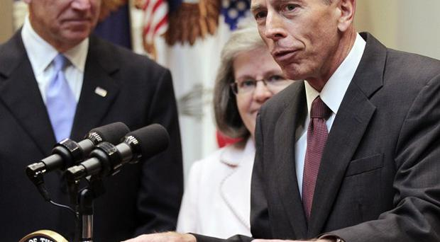 CIA director David Petraeus, right, speaks following his swearing-in ceremony withUS vice president Joe Biden(AP)
