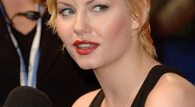 Elisha Cuthbert has no problem with her new TV show being compared to Friends
