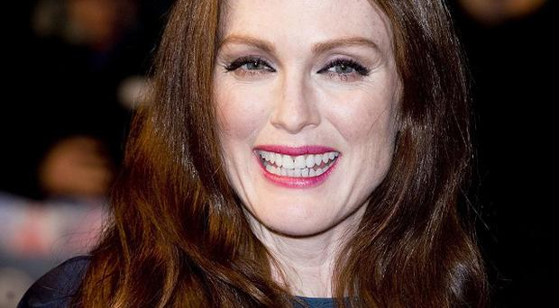 Julianne Moore couldn't wait to get her red hair back