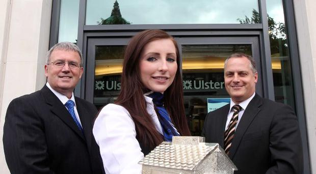 At Ulster Bank's Belfast headquarters, customer advisor Janine Davis is joined by Stephen Cruise (left), managing director of retail banking Northern Ireland, and Derek Wilson, head of lending products, to announce that mortgage rates are being cut by the bank and arrangement fees removed