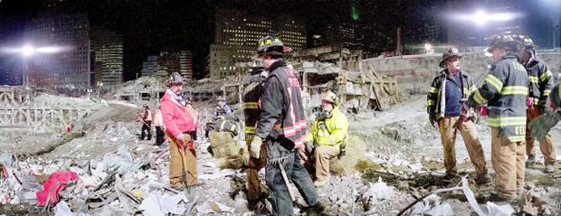 Firefighters working on recovery efforts at the site of the World Trade Center disaster, wait for their shift to start on Friday, Jan. 18, 2002 in New York. Of the nearly 2,900 victims of the attacks of Sept. 11, 2002, 684 have been matched to remains by the medical examiner. (AP Photo/Mark Lennihan)