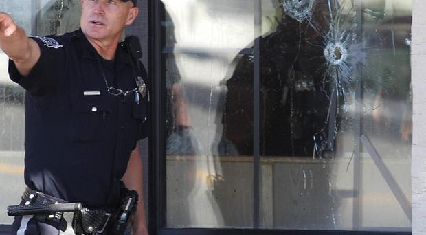 A police officer works at the scene of the shooting in Carson City, Nevada (AP)