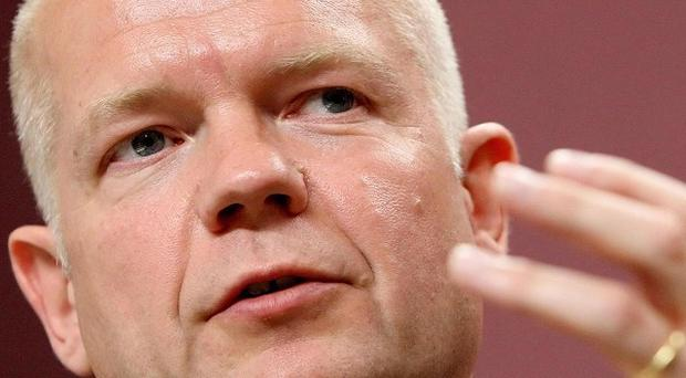 Foreign Secretary William Hague has questioned the last Labour government's 'chumminess' with Muammar Gaddafi's regime
