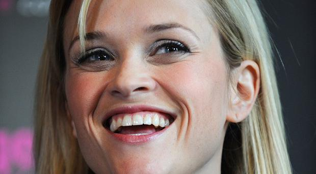 Actress Reese Witherspoon was struck by a car while jogging near Los Angeles