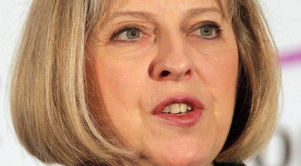 Theresa May has criticised speculation by politicians over the cause of rioting