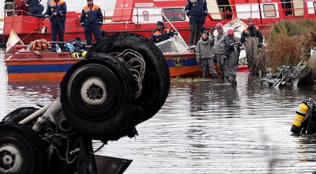 Divers search the wreckage at a crash site near Yaroslavl, on the Volga River (AP)