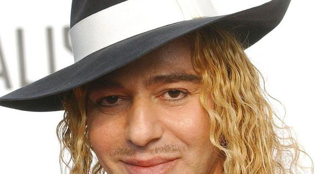 John Galliano is awaiting a verdict in a Paris court over charges he made anti-Semitic insults