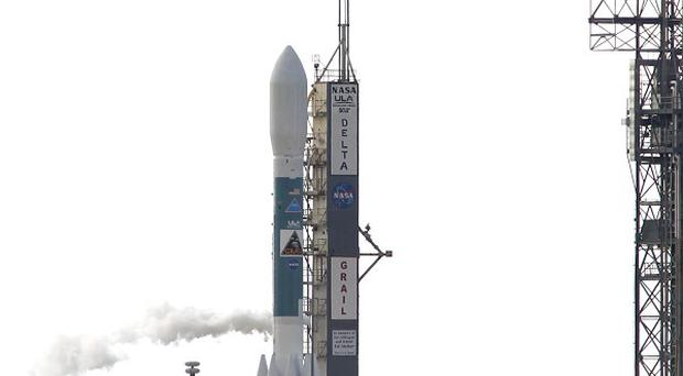 A rocket carrying the Grail moon probes sits on the launch pad at Kennedy Space Centre, grounded by high winds (AP)