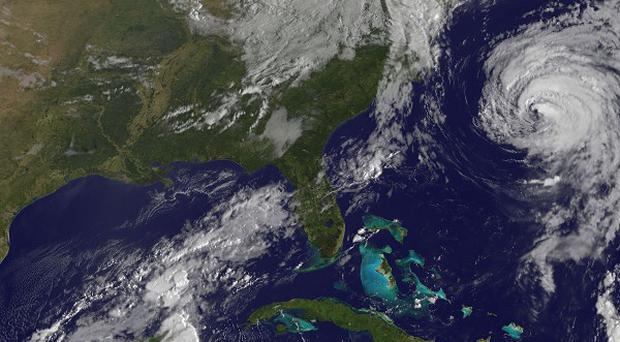 This image provided by Nasa shows Hurricane Katia, upper right, and Tropical Storm Nate, lower left (AP)