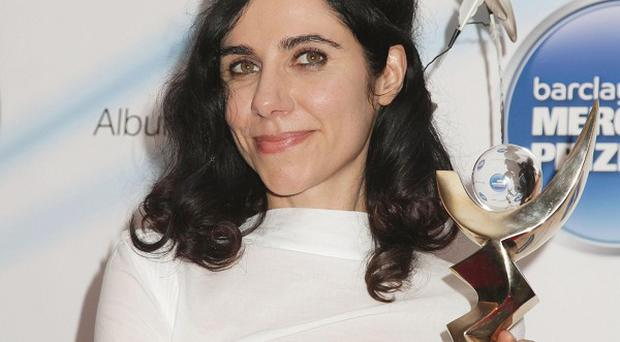PJ Harvey has become the first artist to win the prestigious Barclaycard Mercury Prize for a second time