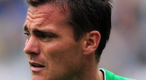 A football fan who ran onto a pitch and floored Steve Harper has been banned from Sunderland and England games