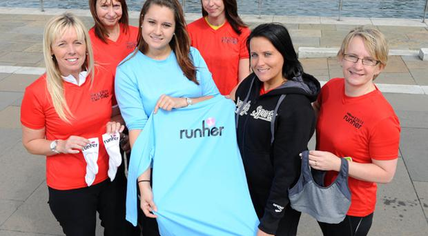Jennifer Watson (centre) from Belfast Telegraph Runher presents Runher's first 'champion' Gillian Logan from Larne with her goody bag. Gillian is pictured with her HP colleagues (from left) Dawn Bowers, Alison Groves, Katie Edwards and Eithne Angelone