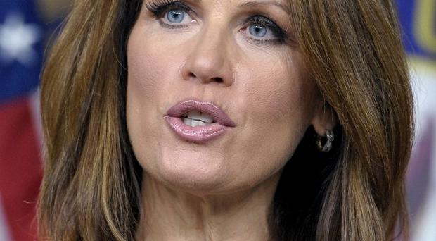 Republican presidential contender Michele Bachmann has criticised President Barack Obama's plan to create jobs (AP)
