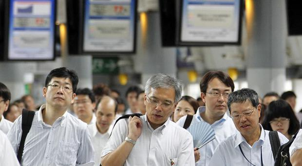 Japan's economy contracted during the April-June quarter at an annual rate of 2.1 per cent, worse than the initial estimate (AP)