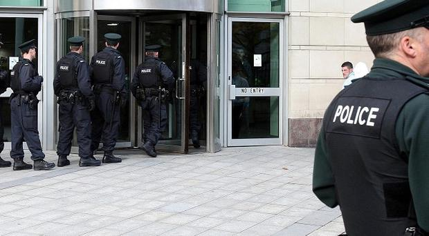 A large police presence outside Belfast Crown Court as 14 men face one of the biggest paramilitary murder trials in decades