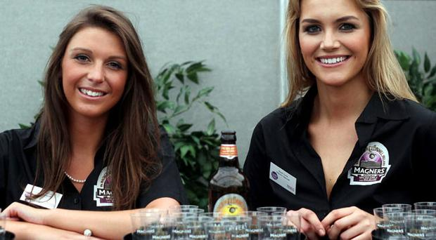 Magners girls Charlotte Sythes and Sarah Ennis prepare for the Taste Festival