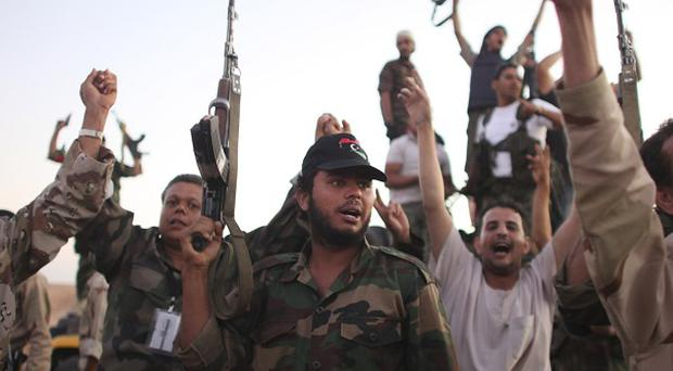 A special unit of fighters is being used to track down former Libyan leader Muammar Gaddafi (AP)