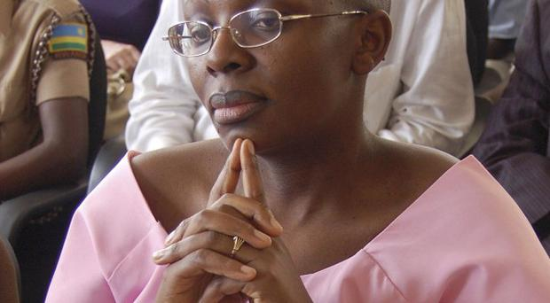Rwandan opposition leader Victoire Ingabire wears handcuffs as she listens to the judge during the her trial in Kigali (AP)