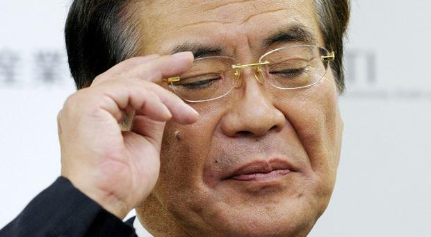 Japan's Trade Minister Yoshio Hachiro has resigned after just eight days in office (AP)