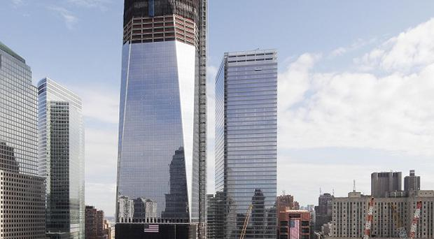 One World Trade Centre overlooks the National September Memorial in New York (AP)