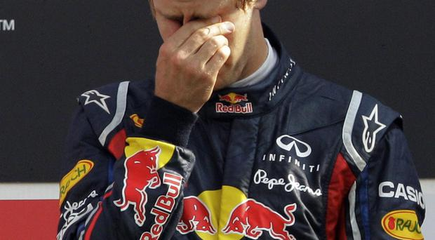 Red Bull driver Sebastian Vettel of Germany gets emotional on the podium after winning the Italian Formula One Grand Prix at the Monza racetrack, in Monza, Italy, Sunday, Sept.11, 2011