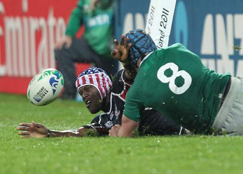 USA's Taku Ngwenya is tackled by Stephen Ferris of Ireland