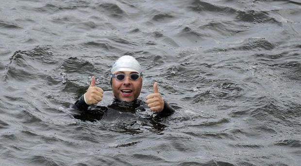 David Walliams continues his challenge to swim the Thames to raise money for Sport Relief