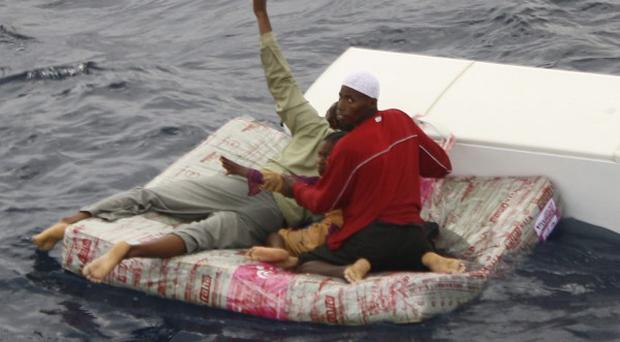 Survivors stay afloat after an overcrowded ship sank between mainland Tanzania and Pemba Island (Whirlwind Aviation)