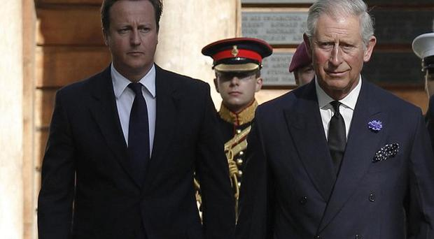 Prince Charles, Prime Minister David Cameron and US Ambassador Louis Susman attend a ceremony in London to commemorate the September 11 attacks