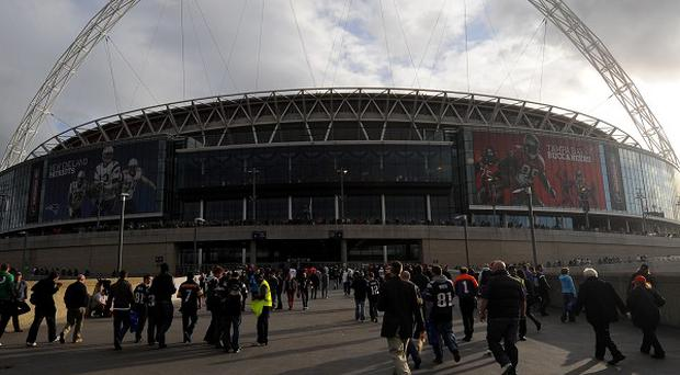 A man will appear in court charged with the manslaughter of a Wales football fan at Wembley